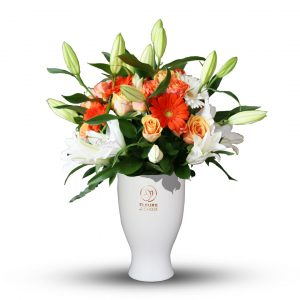 Orange and White Mixed Flowers in White Vase